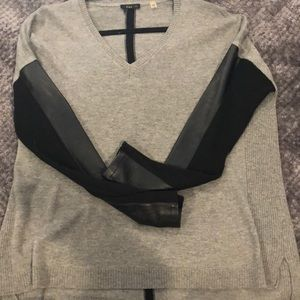 Gray sweater with leather sleeves